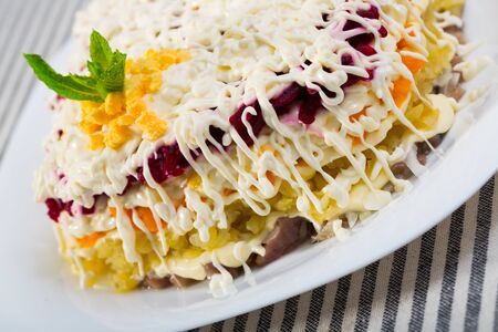 Herring under fur coat - traditional Russian layered salad with salted herring an vegetables