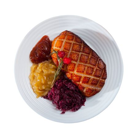Tasty roasted duck breast Magret with pickled cabbage, herbs and sauces on plate. Isolated over white background Banco de Imagens