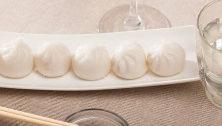 Plate of appetizing steamed dim sum – traditional Chinese dish