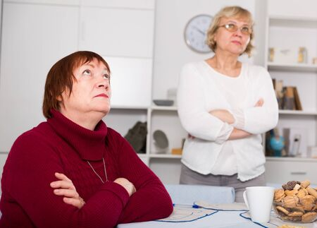 Upset mature woman dont speaking after discord with female friend
