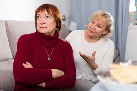 Two upset mature ladies finding out relationship at home