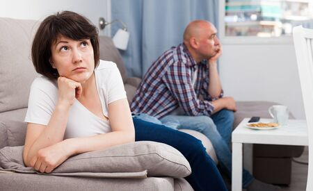 Sad family having difficulties in the living room at home Standard-Bild