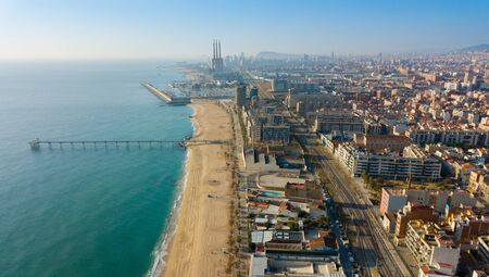 Panoramic aerial view of modern areas in coastal zone of Spanish city of Badalona Фото со стока