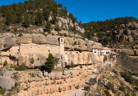 Picturesque rock landscape with medieval Santuario de la Balma built in deep crevice, Valencian Community, Spain Stok Fotoğraf