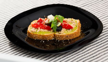 Image of sandwich with canned tuna and vegetables on the plate indoors. Reklamní fotografie