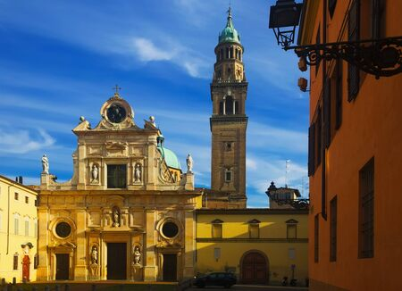 View of bell tower and facade of San Giovanni Evangelista church, Parma, Italy