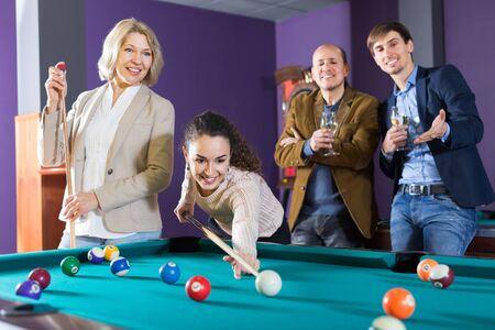 Adults middle class people having pool game in billiard club