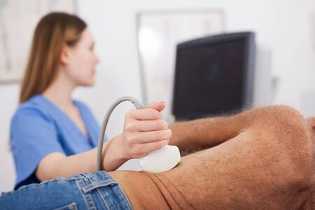 Close up of sonographer using ultrasound probe for ultrasonic patient examination Stock fotó
