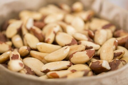 Photo of mix brasilian nut in the food store. Imagens
