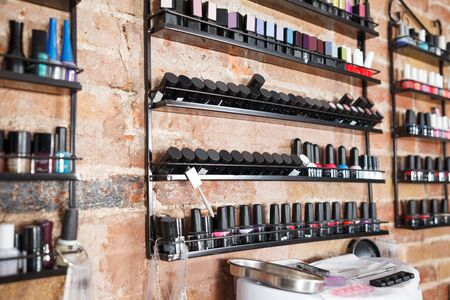 Picture of work place with modern nail polishes and equipment in nail salon