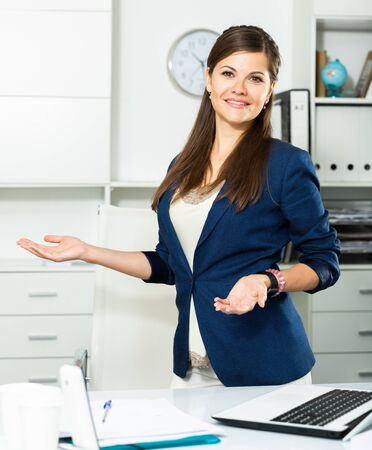 Businesswoman is going to meet first visitors in her office Stockfoto