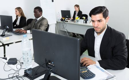 Portrait of successful Hispanic businessman during daily work in modern co-working space Stock Photo