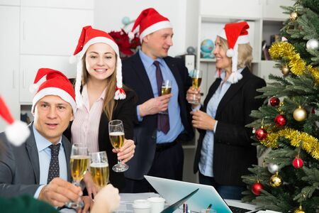 Happy business group people in santa hat at Xmas corporate party Stock Photo