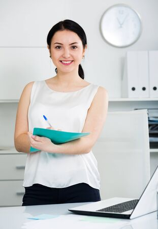 Smiling woman manager waiting for clients in office