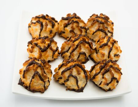 Tasty dessert, coconut cookies with chocolate glaze