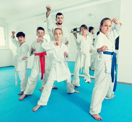 Young teenagers happy to attend a karate class on self-defense