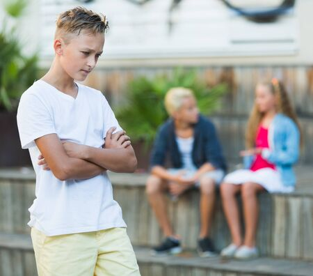 Upset boy offended after quarrel with playmates outside