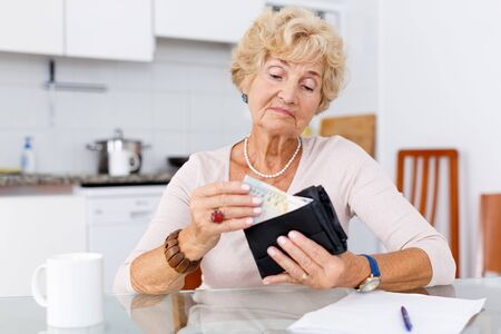 Senior woman is upset because of she has little money