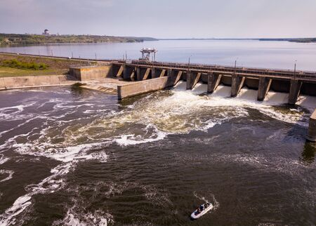 View of river with dam construction and gates near Voronezh, Russia Фото со стока