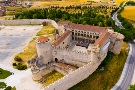 Picturesque summer landscape with medieval Cuellar Castle in Spanish province of Segovia Editorial