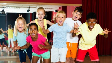 Happy kids having fun in a choreography class during dance lesson