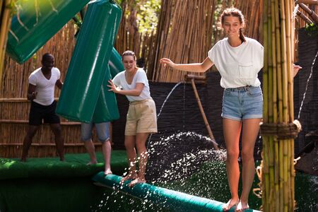 Obstacle course over the water - fun adventure in an amusement park Imagens