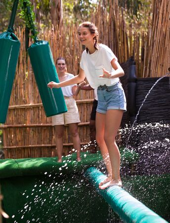 Obstacle course over the water - fun adventure in an amusement park