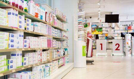 BADALONA, SPAIN - FEBRUARY 20, 2018: Image of various medicines arranged in shelves at pharmacy