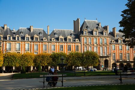 PARIS, FRANCE - October 10, 2018: View of famous Place des Vosges with distinctive architecture of buildings in sunny autumn day
