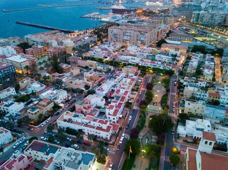 Aerial view of beach and city center of Almeria on cloudy evening, Spain