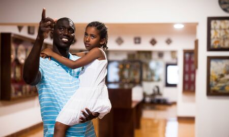 Portrait of African American father and daughter visiting museum of arts Stock Photo