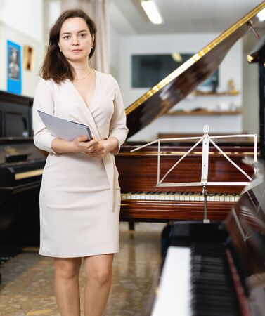 Female assistant or customer at piano music store