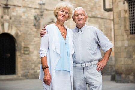 Close up of  happy positive  senior couple on city streets on joint vacation