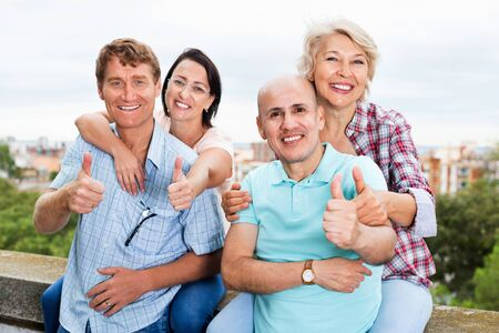 Satisfied pleasant friendly mature couples of pensioners on weekend together