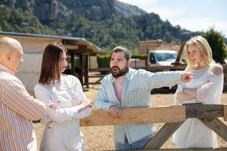 Quarrel of four friends in the country in the village Stock Photo