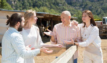 Joyful meeting of friends near the summer farm Stock Photo