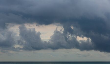 Image of dramatic dark cloudy sky over sea, natural photo background