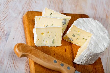 Image of slices of blue cheese with mold at wooden board, nobody Stok Fotoğraf