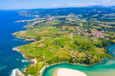 Scenic view from drone of coastal Spanish township of Comillas on sunny summer day, Cantabria