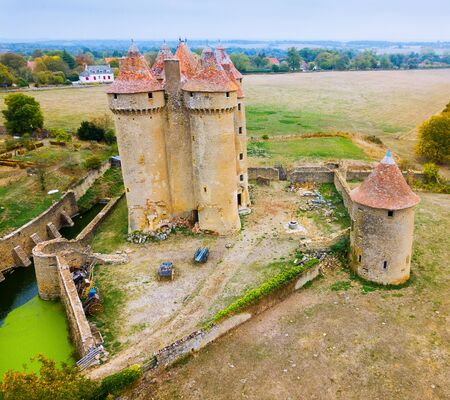 View of gorgeous medieval castle Chateau Sarzay in village of Sarzay, France