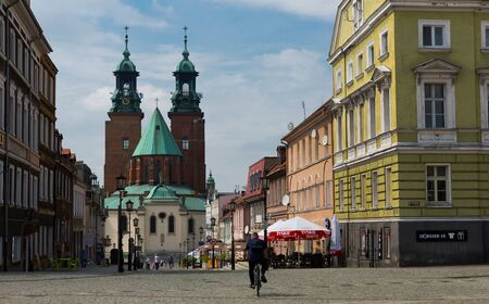 GNIEZNO, POLAND - MAY 11, 2018: View of central street with Roman Catholic Gniezno Cathedral