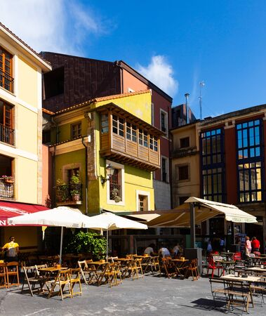GIJON, SPAIN - JULY 15, 2019: Peculiar architecture of streets in residential, commercial and leisure area of old Gijon neighbourhood of Cimavilla Redakční