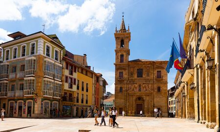 OVIEDO, SPAIN - JULY 15, 2019: Ancient San Isidoro El Real Church on central square of Asturian city of Oviedo in sunny summer day Redakční