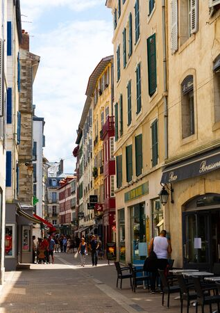 BAYONNE, FRANCE - JULY 17, 2019: View of narrow pedestrian streets of French city of Bayonne in summer day