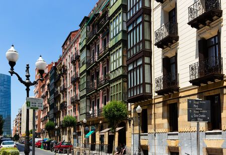 BILBAO, SPAIN - JULY 16, 2019: View of streets of Bilbao city with traditional and modern architecture in summer day