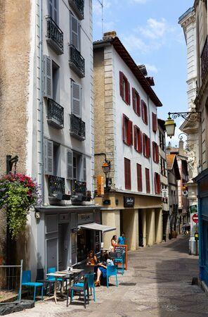 BAYONNE, FRANCE - JULY 17, 2019: Picturesque summer cityscape overlooking vibrant pedestrian street Redakční