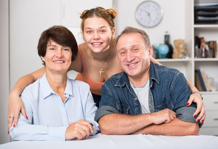 Portrait of happy family at the table at home. Stock Photo