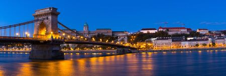 Photo of night Chain Bridge near Buda Fortress in Hungary outdoor.