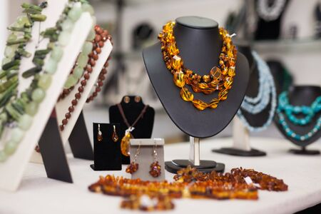 Womens jewelry from amber in a jewelry store Stok Fotoğraf - 130050883