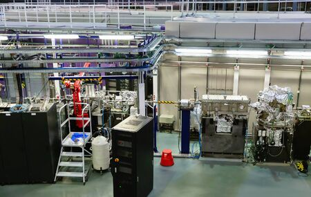 View of experimental stations and modules in interior of modern scientific research center